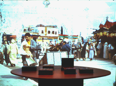 Morocco Memory II by Vibeke Sorensen at Interactive Frictions, University of Southern California, 1999. It is a multimodal immersive installation engaging all of the senses including touch and aroma, that allows the audience to navigate and connect texts, photographs, movies, music, sound and light to navigate culture memory and provide an individual and collective experience. Boxes with spices in them employed embedded systems to transmit wireless signals to the computers to begin navigation of the lexia and media. The metaphor was the mixing of aromas is like the mixing of memories.