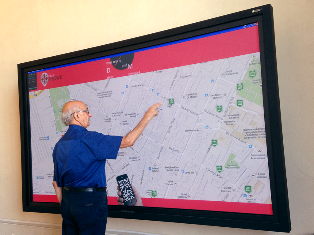An overview of the interactive system placed in the multimedia hall of the tourist information office.